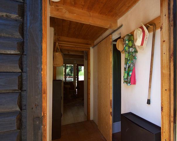RabunaDesign interior design Prague wooden summer house cottage hallway brick tiles corridor hanger Czech rustic