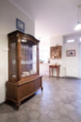 interior design czech prague entry hall antique hutch vintage wood gray porcelain tile hexagon floor