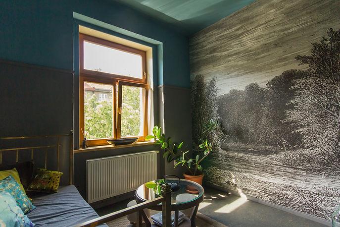 interior design Prague Czech dark interior wall mural brass bed living room
