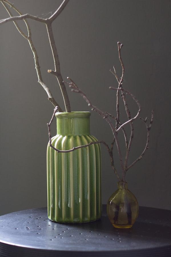 interior design Prague Czech detail green vase still life twigs drk interior