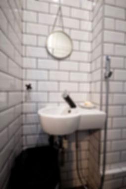 white interior design czech prague restroom powderrom blac tap faucet subway tiles nordic scandi
