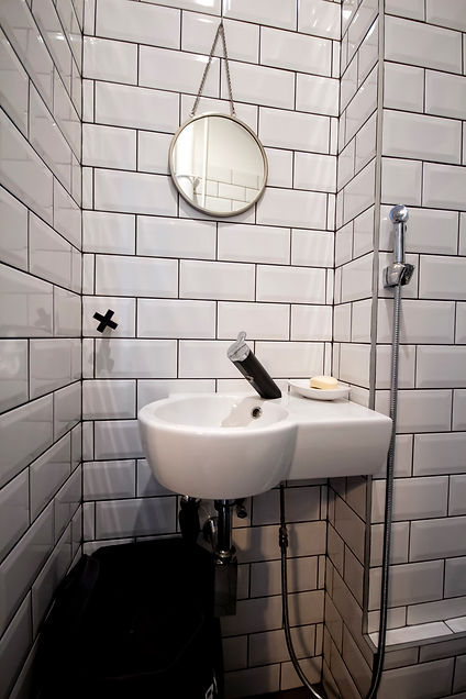 white interior design czech prague restroom powderrom blac tap faucet subway tiles nordic scandi