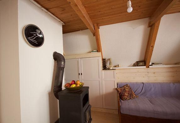 návrhy interiéru RabunaDesign dřevěná chata obytná místnost