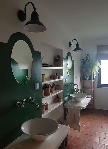 interior design Prague Czech  bathroom green brick tiles double sink Tuscan rustic indoor plants