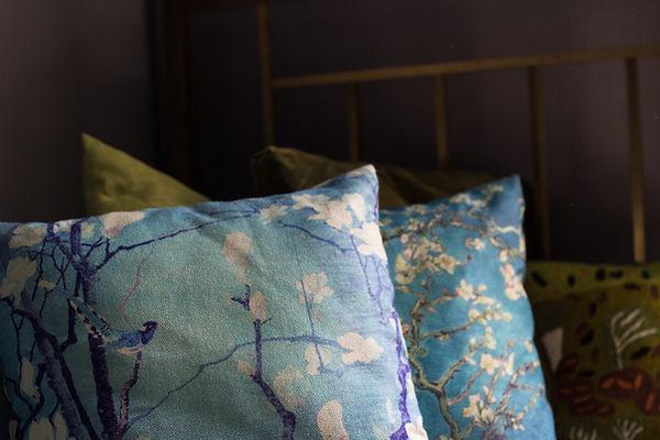 interior design Prague Czech pillows cushions brass bed dark interior