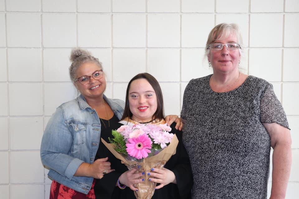 Lindsay (Center) at her high school graduation