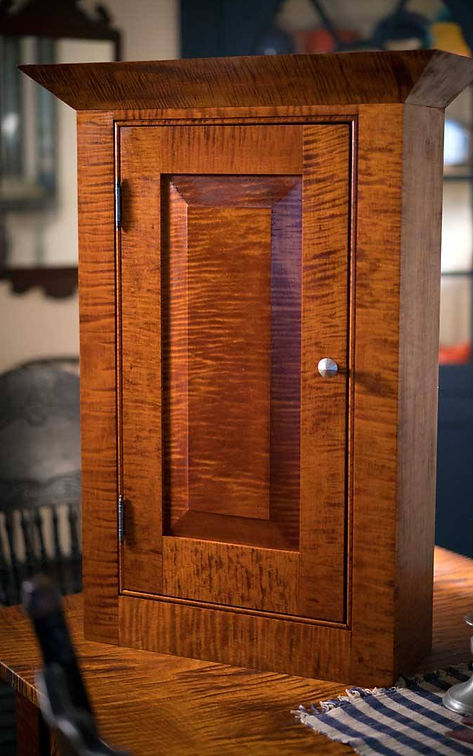 Early american tiger maple pewter cabinet