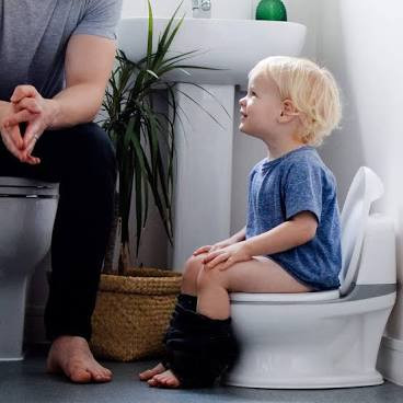 Young child being toilet trained