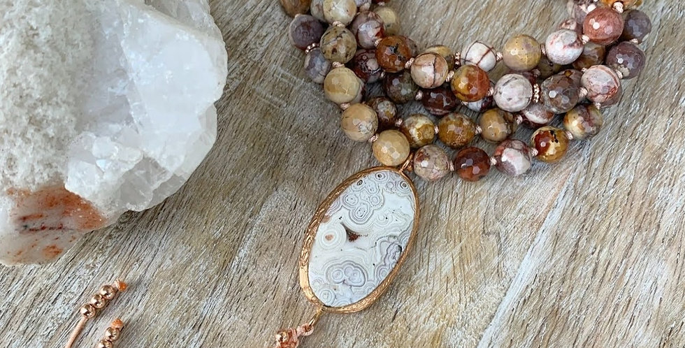 Ryolite Mala with Crazy Lace Agate Guru Bead