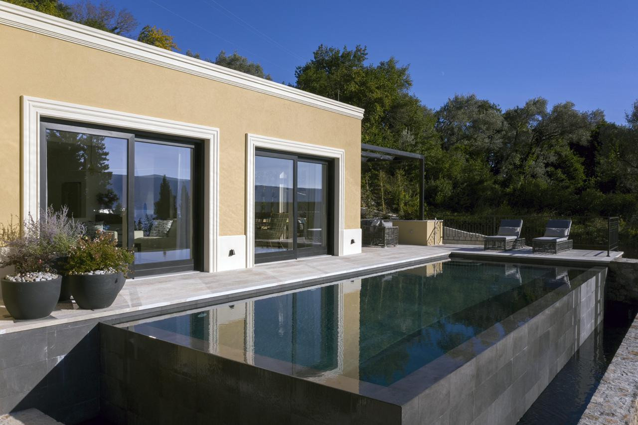 21 - Great room facade and pool.jpg