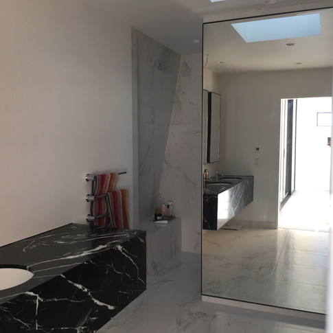 Large steel trimmed wall mounted mirror with demister.