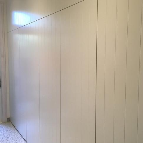Storage Units behind wall of TG&V 'push-to-open' doors/panels.