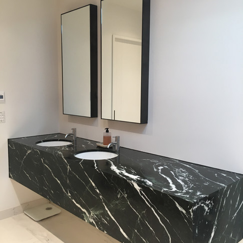 FFL Bathroom vanity   Marine Ply structure mounted to custom wall brackets clad in marble.  LED strip lighting to underside.     FFL Bathroom overhead cabinets  Trimmed in steel plate, mirrors with demisters, LED lighting within.