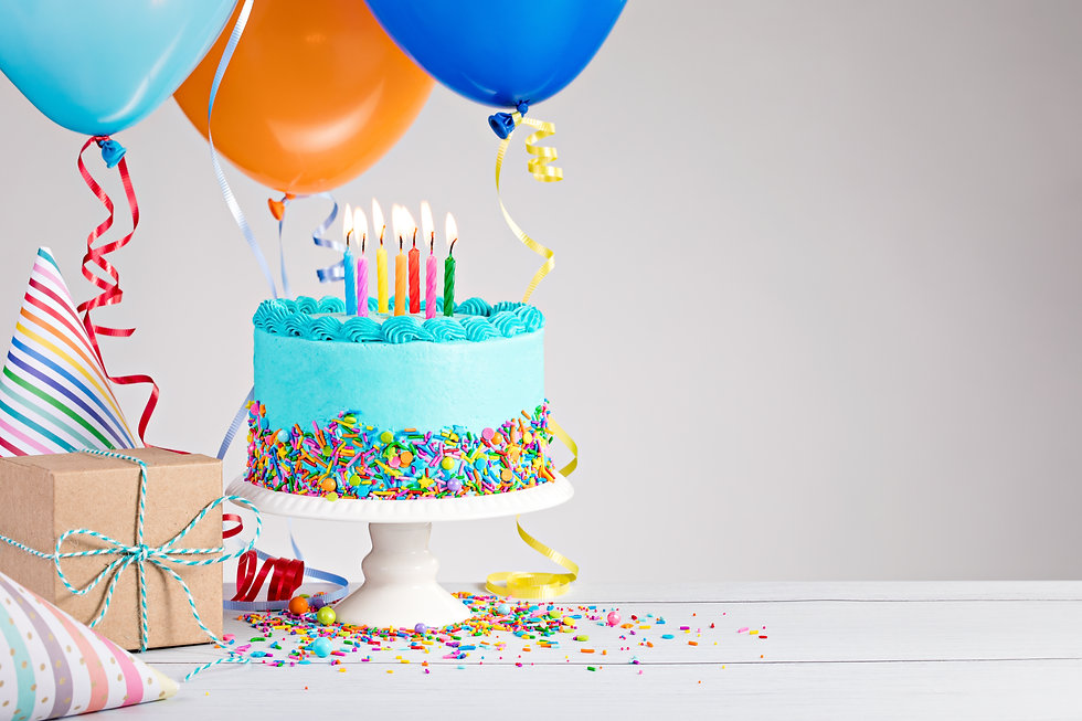 Blue Birthday cake, presents, hats and colorful balloons over light grey..jpg