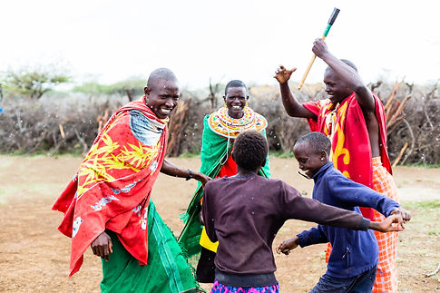 Massai family celebrating and dancing.jp