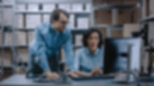 Two Microsoft Dynamics 365 Solution Partners Looking at a Computer Screen