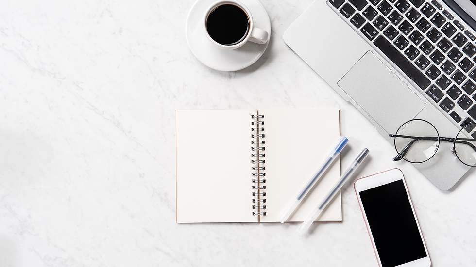 Background image of notepad and phone on a desk