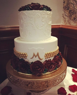 Dark rich burgundy roses and super gold detailing for Mr & Mrs Mascaro's gorgeous intimate wedding!
