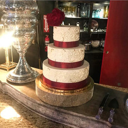 Gorgeous buttercream scrolling on this three tiered beauty! Congratulations to the new Mrs. and Mr.
