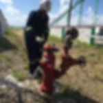 Total Fire Solutions - Performing annual maintenance on a fire hydrant