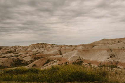 Traveling cross-country through the Badlands in South Dakota in a renovated 1962 Airstream Overlander, by Coviello Photo.