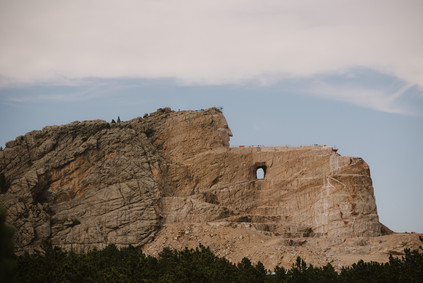 Traveling cross-country through Crazy Horse Memorial in South Dakota in a renovated 1962 Airstream Overlander, by Coviello Photo.