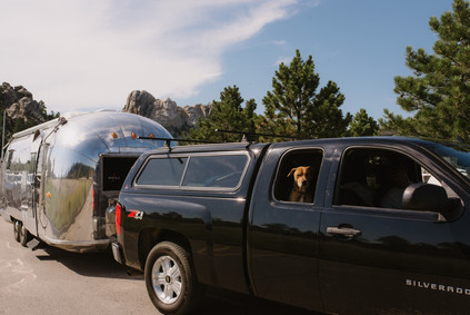 Traveling cross-country through Mount Rushmore in South Dakota in a renovated 1962 Airstream Overlander, by Coviello Photo.