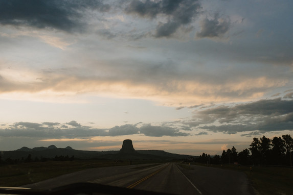 Driving through Devils Tower National Monument in Wyoming, in a renovated 1962 Airstream Overlander, by Coviello Photo.