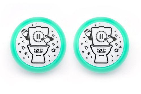 Two aqua potty pause push-button lights.  Fun and helpful potty training tool for toddlers