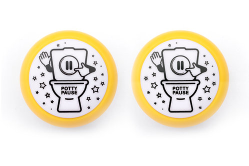 Two yellow potty pause push-button lights.  Fun and helpful potty training tool for toddlers