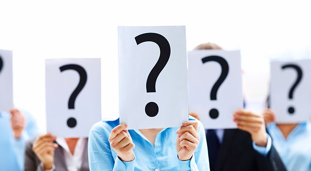 people holding up signs with question marks