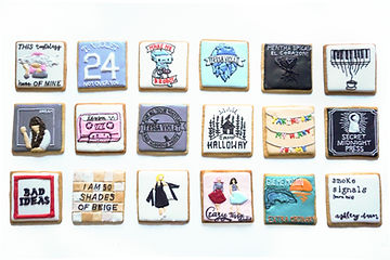 Custom decorated sugar cookies for Tessa Violet and Secret Midnight Press of their album covers, book covers, merchandise, and fan art