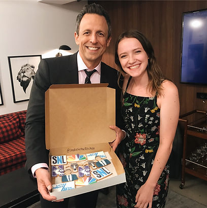 Seth Meyers holding custom cookies from Cookie in the Kitchen with Emily Henegar