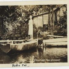 Nettie Fox in front of her cabin