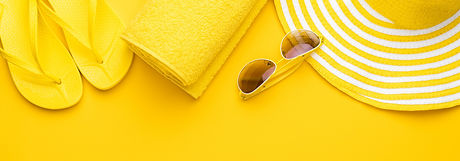 beach%20accessories%20on%20the%20yellow%20background%20-%20sunglasses%2C%20towel.%20flip-flops%20and