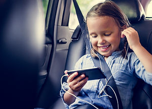Girl listening to music in the car.jpg