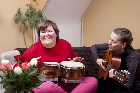 Two women make a music therapy and havin