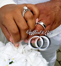 Bride and Groom displaying their wedding rings after the wedding ceremony.