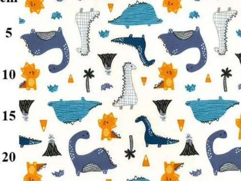 popeline-tissu-dinosaures-multicouleurs-sur-textile-ivoire-aux-ateliers-dyvonne