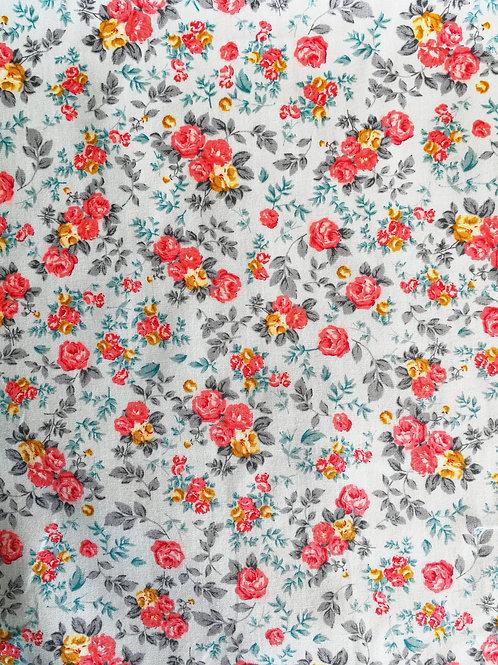 Coton popeline fleurs jaunes et roses sur tissu bleu ciel