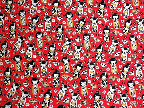 Popeline imprimé Kokeshi sur fond rouge