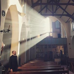 sunlit church and Fr.jpg
