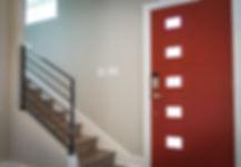 red-wooden-door-beside-stairs-922796.jpg