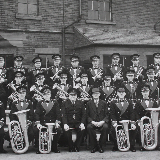 BARROW SHIPYARD BAND 1952.jpg Photo supplied by Clarry Dunlop. Back L-R Jack Walmsley, Grenville Huckerbee, David Clelland, Bill Clegg, Les Lowther, George Walker, Tommy Johns, Ray Throughton, Frank Williams, Brian Martin, Tommy Jackson. MiDDLE L-R Jack Quayle, Bob Fisher, Bram Longstaffe, Jimmy Hargreaves, Albert Head, Harry Pollard, Jim Everett,  Lol Lanegan, Tom Jones. FRONT L-R Norman Martin, Joe Woods, Bob Latimer, Herbert Sutcliffe Conducter, Walter Wilson, Bill Jackson, Arthur Corner, Frank Smith.
