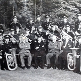 The Barrow Steelworks Band, 1951-52. Photo supplied by Clarry Dunlop. Back Row l-r Clarry Dunlop, Stan Thompson, Harry Vincent, Ron Cowell, George Pettinger, Jack Jones, Brian Judge, George McIntire, Billy Leonard. Centre Row L-T Bill Tranter, ?, Alan Grierson, Hanry Baker, Ernie Fullard,Bob Griffiths, Harry Walmsley, George Hurley, Ronnie Griffiths, John Mason, Dickie Dent. Front Row L-R Harry Cowell. ?, ?, Jack Jacobs Conducter, ?, Joe Dunlop, George Kirby.
