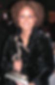 tonya-dark-back-holding-award-bio.png