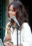 tonya-light-back-holding-award-bio.png