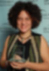 woman-holding-award.png
