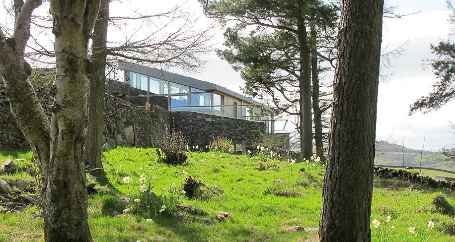 Stone eco home nestled among trees