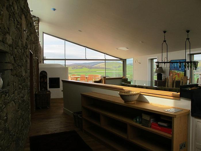 Contemporary eco home interior with glazed wall